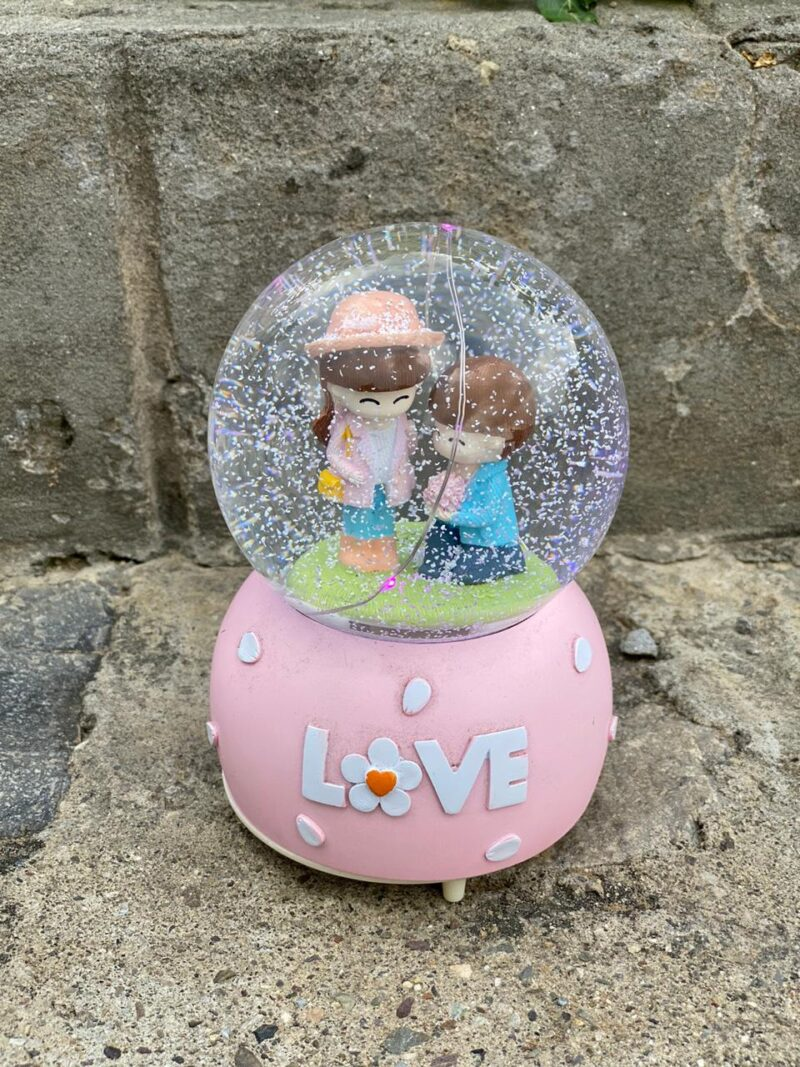 Couple in a glass globe